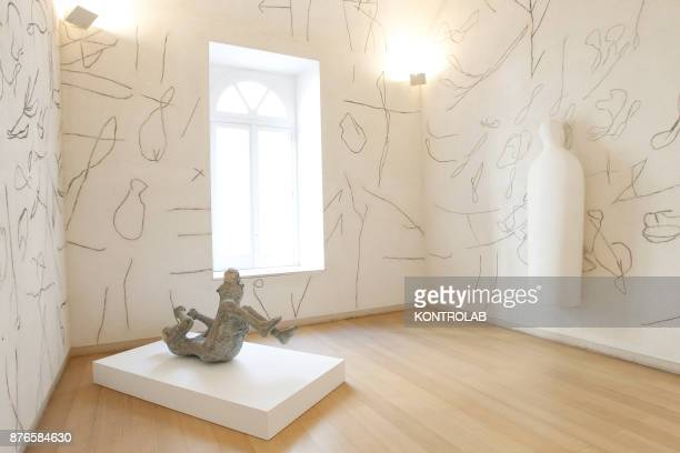 MUSEUM NAPLES CAMPANIA ITALY Pietrified victims of the 79 AD eruption of Vesuvius volcano are displayed near the work of Mimmo Palladino the...