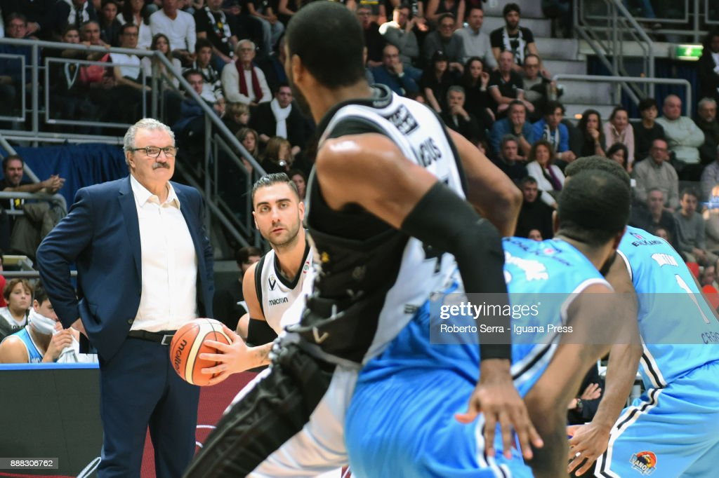 Pietro Aradori (L) and Marcus Slaughter (R) of Segafredo competes with Landon Milbourne (L) Kelvin Martin (R) of Vanoli under the look of Romeo Sacchetti head coach of Vanoli during the LBA LegaBasket of Serie A match between Virtus Segafredo Bologna and Vanoli Cremona at PalaDozza on December 3, 2017 in Bologna, Italy.