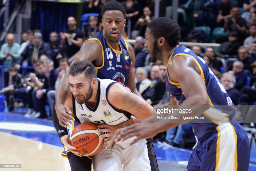 Pietro Aradori (C) of Segafredo competes with Lamar Patterson (L) and Trevor Mbakwe (R) of Fiat during the LBA LegaBasket of serie A match between Virtus Segafredo Bologna and Auxilium Fiat Torino at PalaDozza on December 17, 2017 in Bologna, Italy.