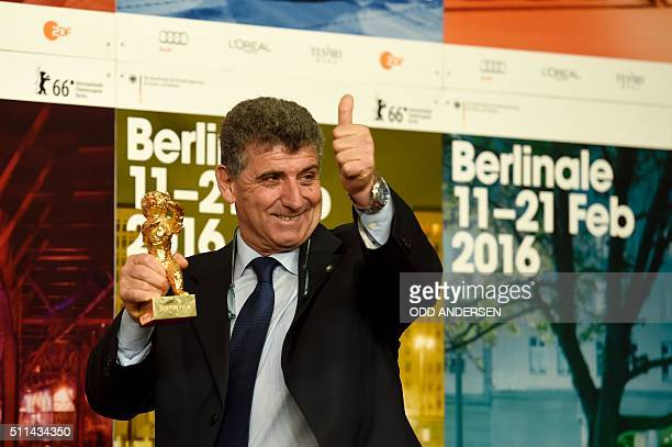 Pietro Bartolo director of a hospital on the Italian island of Lampedusa holds the Golden Bear or Best Film won by Italian director Gianfranco Rosi...