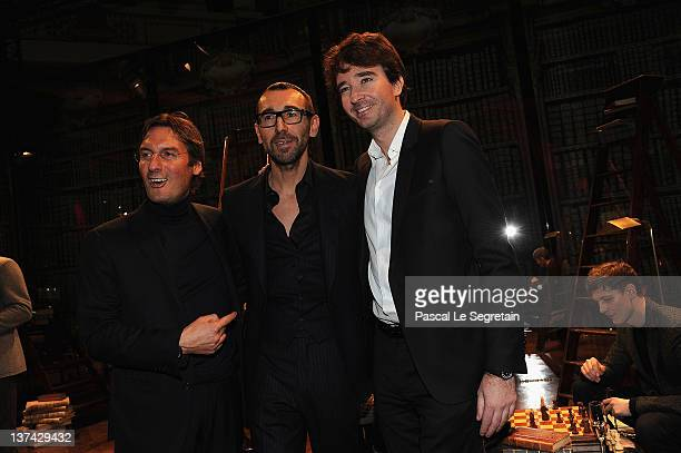 Pietro Beccari Alessandro Sartori and Antoine Arnault pose during the Berluti Menswear Autumn/Winter 2013 show as part of Paris Fashion Week on...