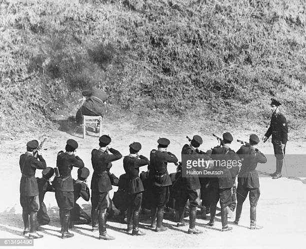 Pietro Caruso an Italian fascist who was responsible for the death of many of his countrymen during the Second World War is shot in the back of the...