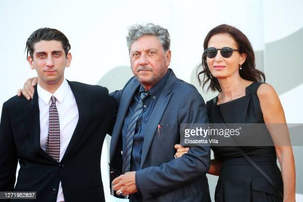 """Pietro Castellitto, Sergio Castellitto and Margaret Mazzantini walk the red carpet ahead of the movie """"I Predatori"""" at the 77th Venice Film Festival..."""