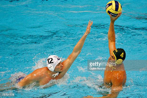 Pietro Figlioli of Australia looks for the pass past Goran Fiorentini of Italy in the Men's Final Round Water Polo match between Italy and Australia...