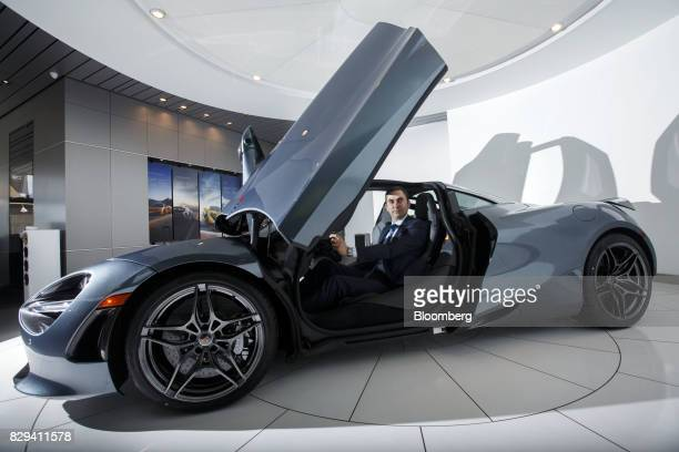 Pietro Frigeriom owner of McLaren Newport Beach sits for a photograph inside a McLaren Automotive Ltd 720S vehicle at the dealership in Newport Beach...