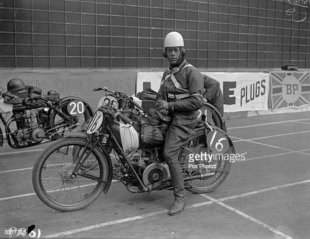 Pietro Ghersi a competitor in the Tourist trophy Race in the Isle of Man astride his machine before the race