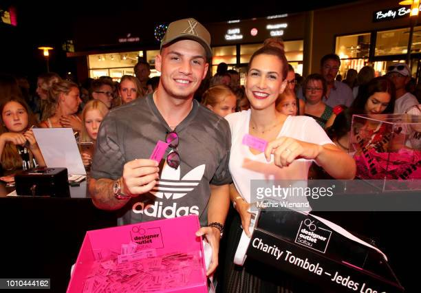 Pietro Lombardi and CleaLacy Juhn at the Late Night Shopping at Designer Outlet Soltau on August 3 2018 in Soltau Germany