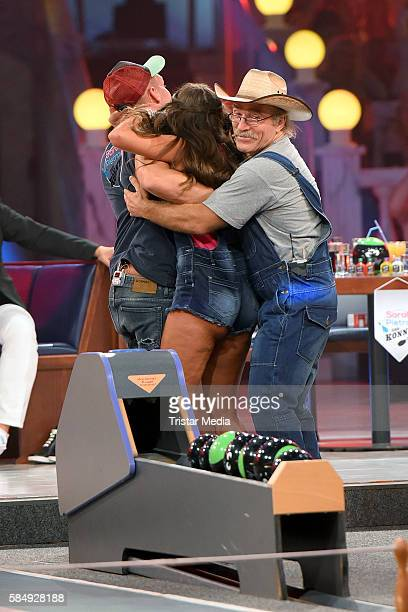 Pietro Lombardi his wife Sarah Lombardi and Konny Reimann during the tv show 'Der grosse RTL IIPromiKegelabend' on July 31 2016 in Winterberg Germany