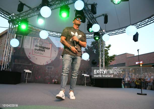Pietro Lombardi performs at the Late Night Shopping at Designer Outlet Soltau on August 3 2018 in Soltau Germany