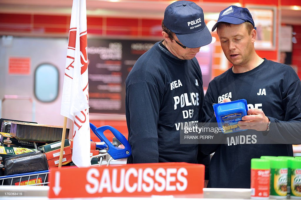 Pig and poultry farmers, members of the French FNSEA union, remove food in a Leclerc supermarket to protest against meat from foreign countries on June 10, 2013 in Saint-Herblain, near Nantes.
