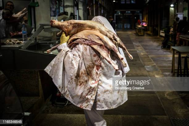 pig carcasses at a spanish food market - slaughterhouse stock pictures, royalty-free photos & images