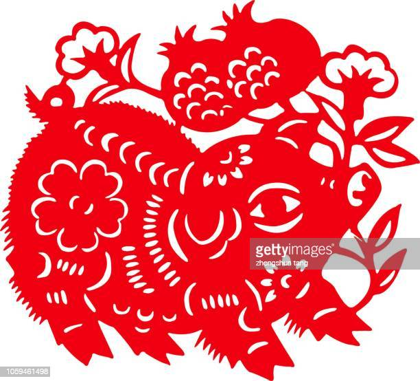 pig paper-cut of chinese zodiac - chinese new year stock pictures, royalty-free photos & images