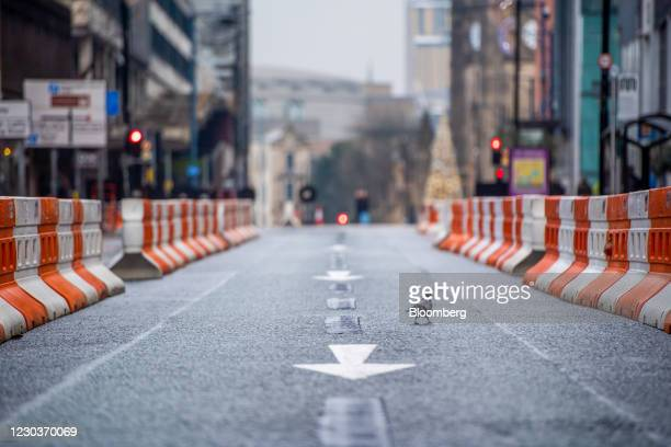 Pigeon an empty Deansgate in Manchester, U.K., on Thursday, Dec. 31, 2020. From Thursday, three-quarters of the population of England -- 44.1 million...