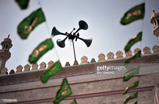 A pigeon rests on loudspeakers at a mosque in the old town section of Multan on March 17 2012 Multan one of the oldest cities in the Asian...