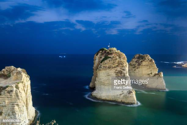 pigeon rocks, a natural landmark of beirut, lebanon - rocky coastline stock pictures, royalty-free photos & images