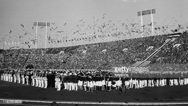 Pigeons are released from the stadium during the opening ceremony at the National Stadium for the XVIII Summer Olympic Games on 10th October 1964 at...