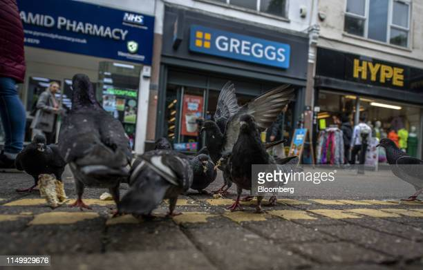 Pigeons eat scraps of food outside a Greggs Plc sandwich shop in the Woolwich district of London UK on Thursday June 13 2019 My frustration is the...