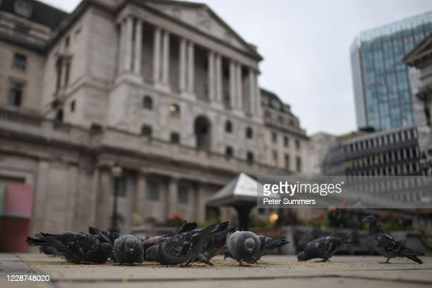 Pigeons eat seeds outside the Bank Of England on September 27, 2020 in London, England. In a recent interview, Bank of England policymaker Silvana...