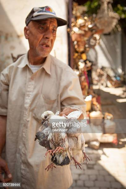 Pigeons for sale in the Medina of Fez Morocco.