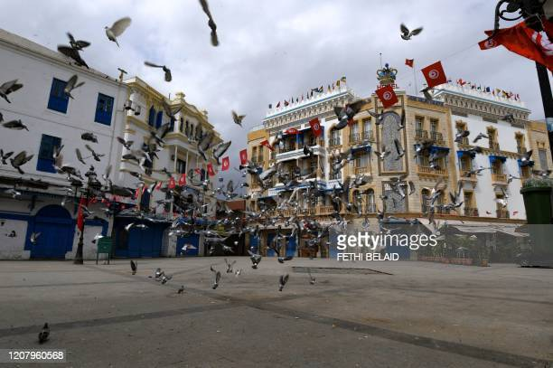 Pigeons hover above a deserted square near the souk of the Medina, on the first day of a general confinement imposed by the authorities in order to...
