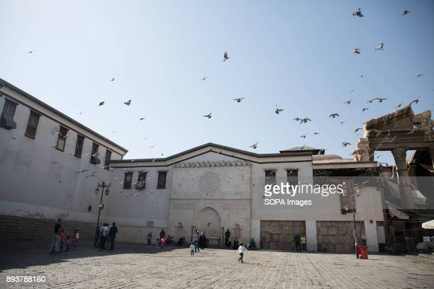 Pigeons outside the Umayyad Mosque scatter at the sound of bombing in the nearby besieged suburbs of Jobar and East Ghouta Despite the ongoing...