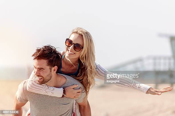 piggy back at the beach - la beach stock pictures, royalty-free photos & images