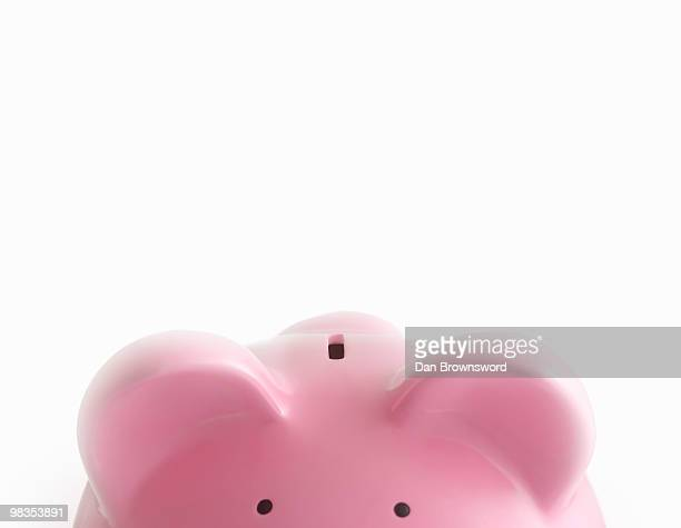 piggy bank against white - piggy bank stock photos and pictures