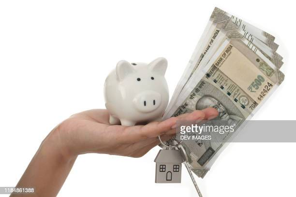 piggy bank and indian currency notes-savings concept - wages stock pictures, royalty-free photos & images