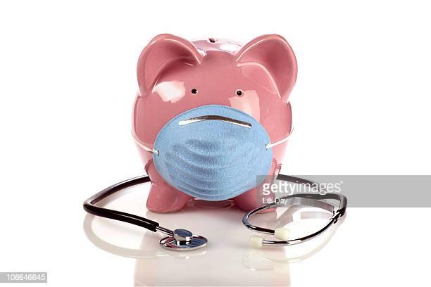 piggy bank and stethoscope  - kirurgmask bildbanksfoton och bilder