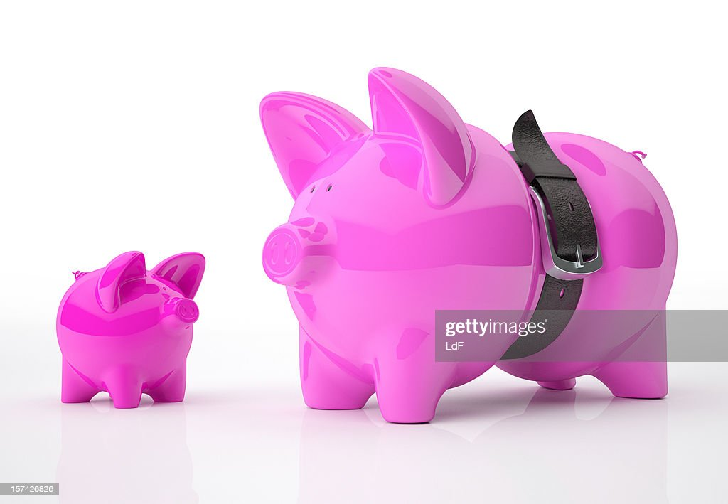 Piggy Bank father and son, Leather belt squeezing the dad. : Stock Photo