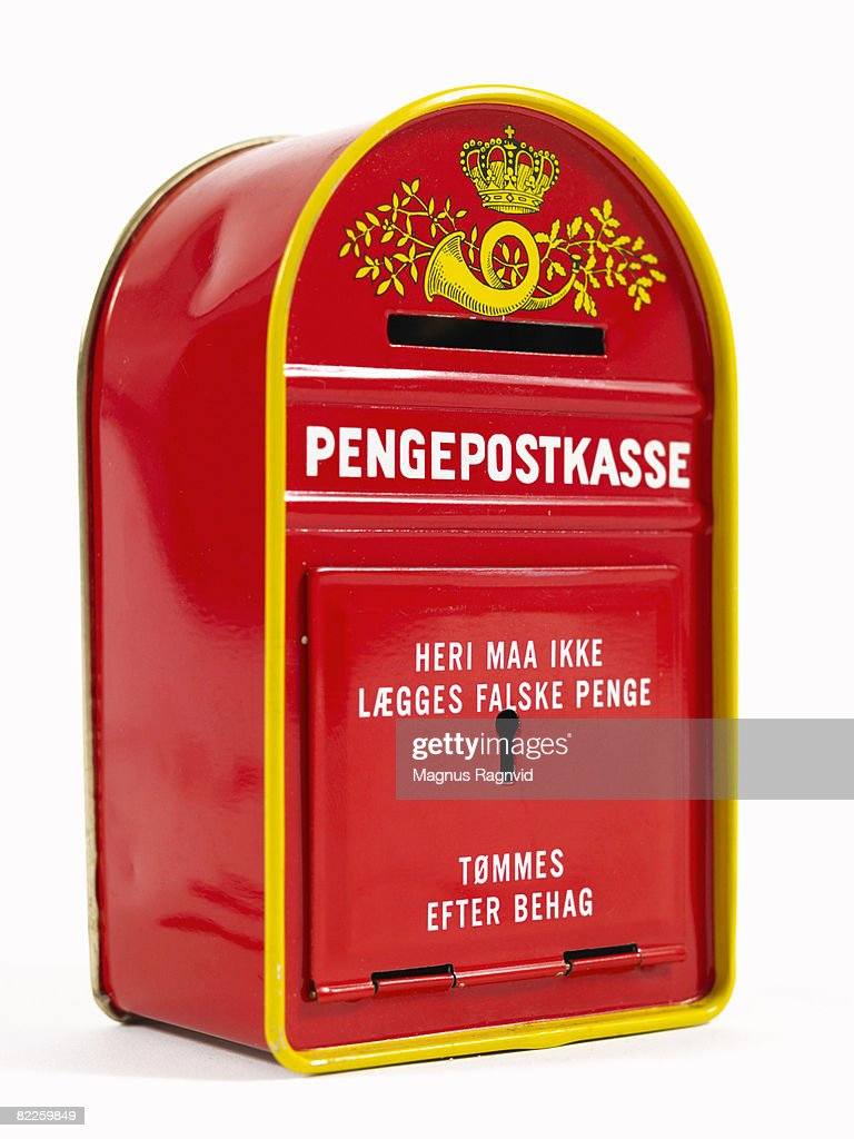 A piggy bank in the shape of a Danish mailbox. : Stock Photo
