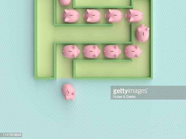piggy bank leaving  a maze
