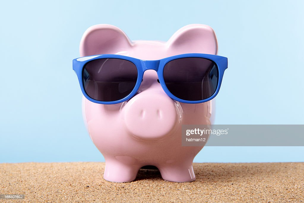 Piggy Bank on beach vacation : Stock Photo