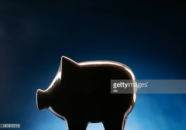 piggy bank on dark blue black background - dark blue stock pictures, royalty-free photos & images
