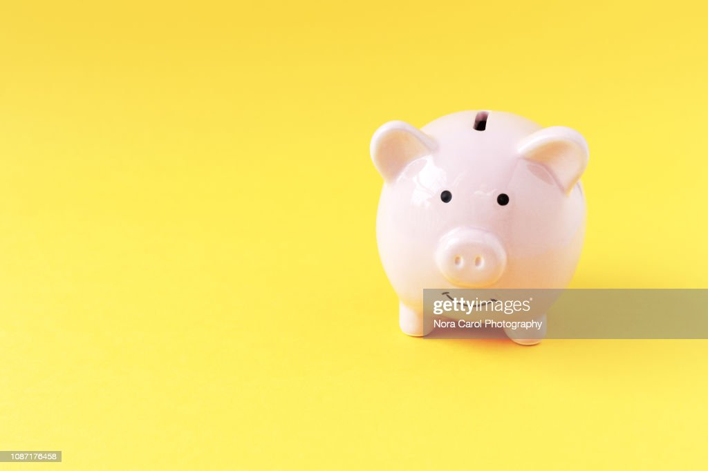 Piggy Bank on Yellow Background : Stock-Foto