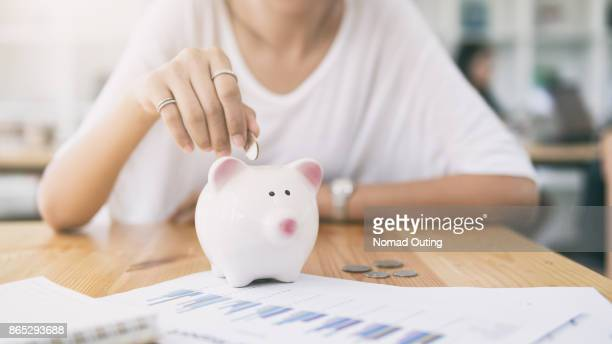 piggy bank saving money concept - ersparnisse stock-fotos und bilder