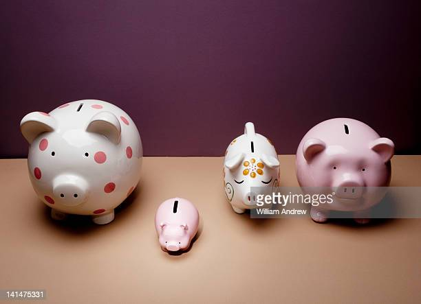 Piggy bank standing out from row