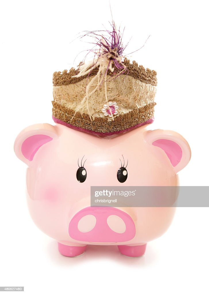 piggy bank wearing indian prince hat : Stock Photo