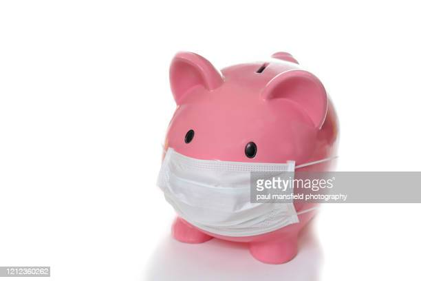 piggy bank wearing protective mask - saving stock pictures, royalty-free photos & images