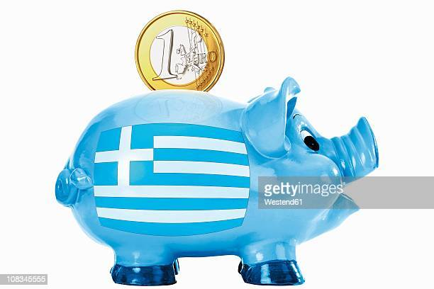 piggy bank with 1 euro coin and greek flag - monetary policy stock pictures, royalty-free photos & images