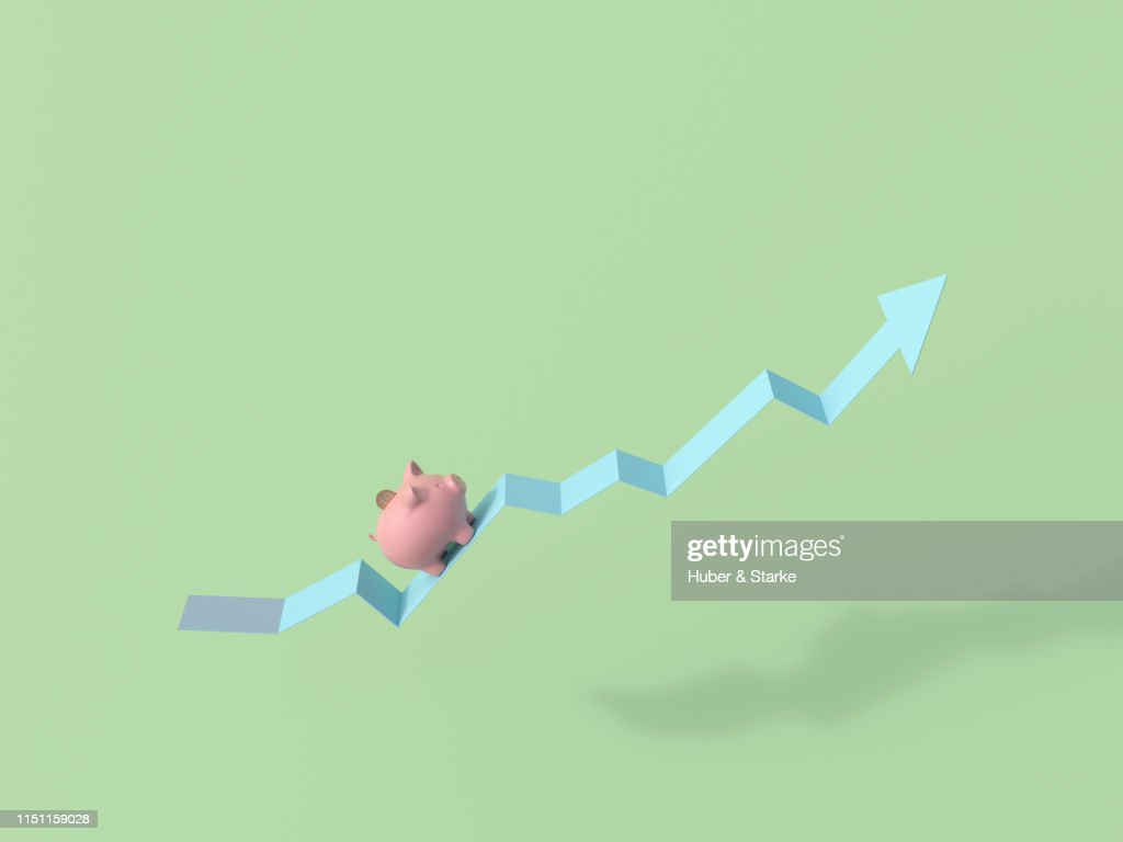 piggy bank with coin on arrow : Stock Photo
