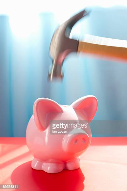 Piggy Bank with hammer about to strike.