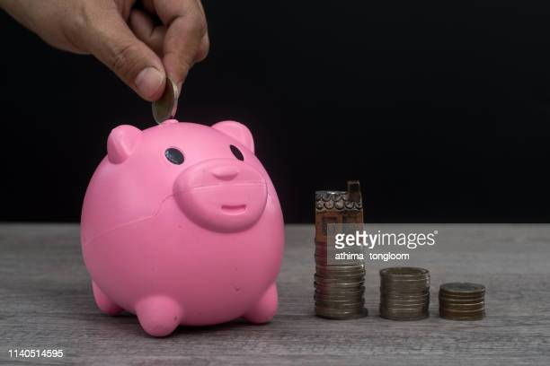 piggy bank with money coins in jar.saving and investment concept - donate icon stock photos and pictures