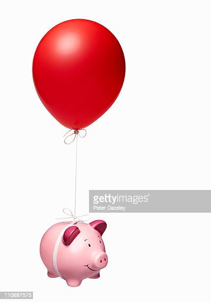 Piggy bank with red balloon