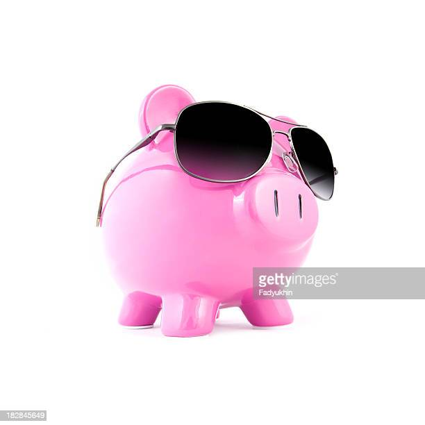 Piggy bank with sunglasses on a white background