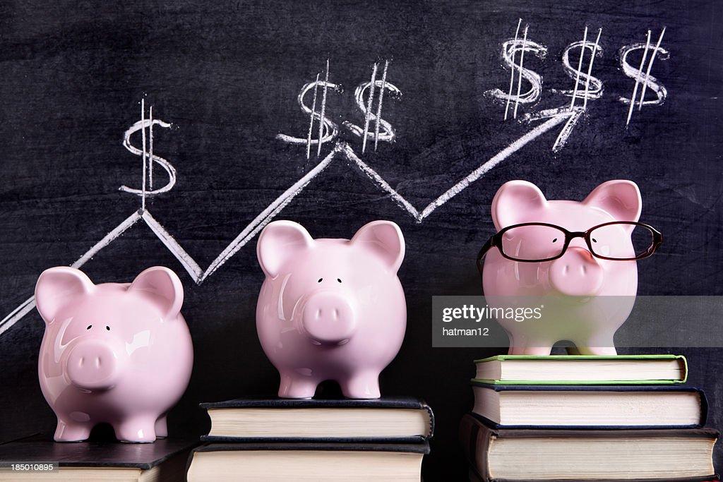 Piggy Banks with savings chart : Stock Photo