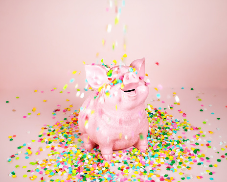 Piggy Coin Bank with Falling Confetti - gettyimageskorea