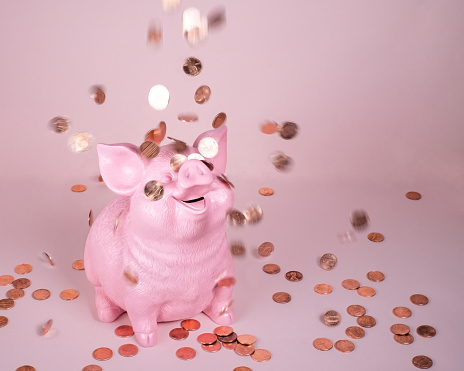 Piggy Coin Bank with falling pennies - gettyimageskorea