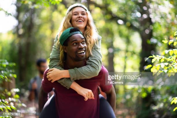piggyback hiking stock photo - piggyback stock pictures, royalty-free photos & images