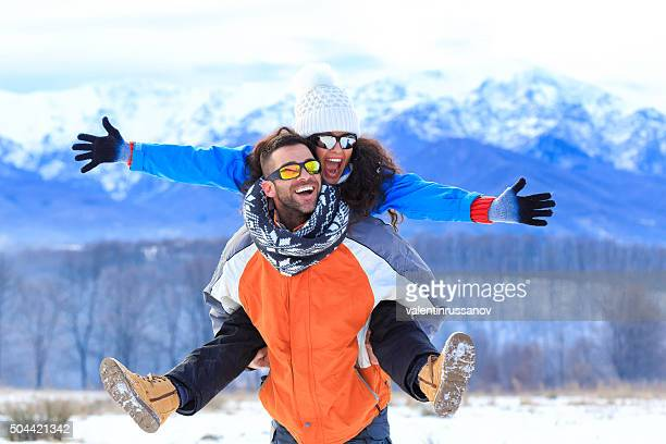 Piggyback in the winter mountain